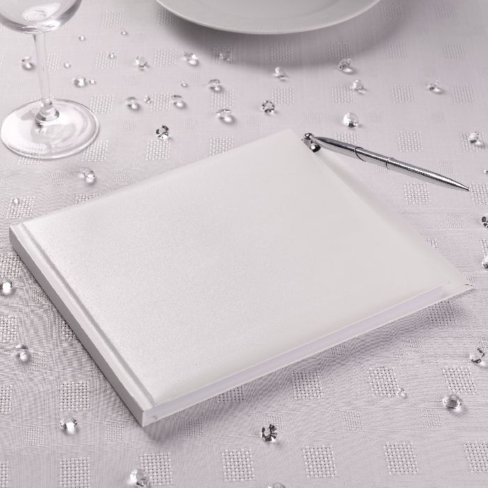 image of guest book with pen